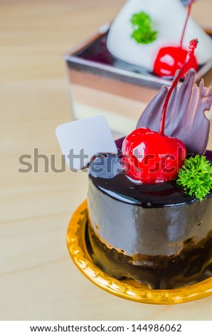 Chocolate cake with cherry on top