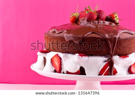 chocolate cake with cream and strawberry