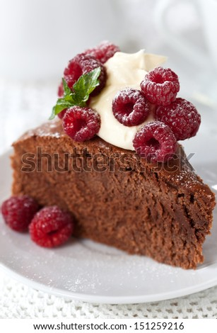 Chocolate cake with fresh raspberries and cream cheese frosting