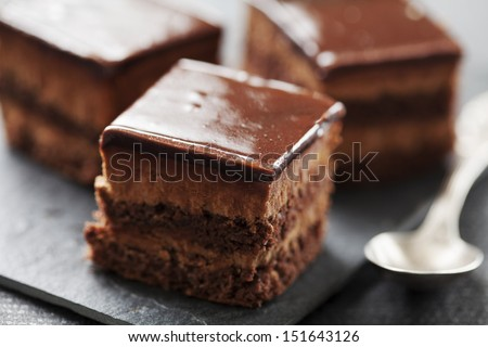 chocolate cake with layers of chocolate mousse - stock photo