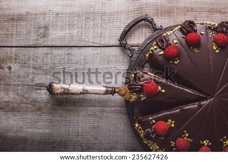 Chocolate cake with marzipan and raspberries - stock photo