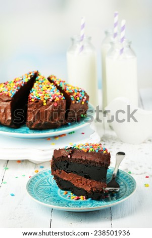 Chocolate cake with milk on table close-up - stock photo