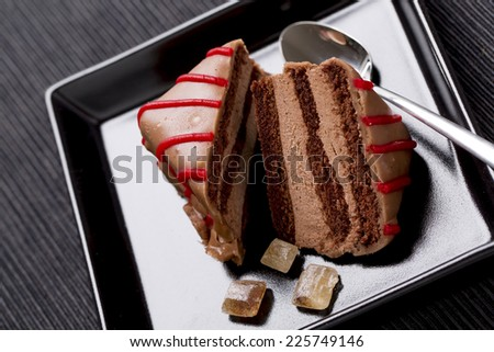chocolate cake with red decoration on the plate