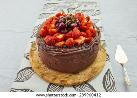 Chocolate cake with red strawberry and merry - stock photo