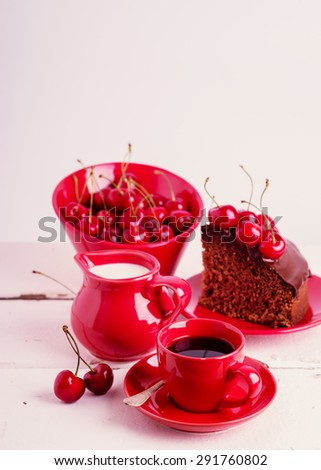 Chocolate cakes with cherries for breakfast and cup of coffee. Selective focus. - stock photo