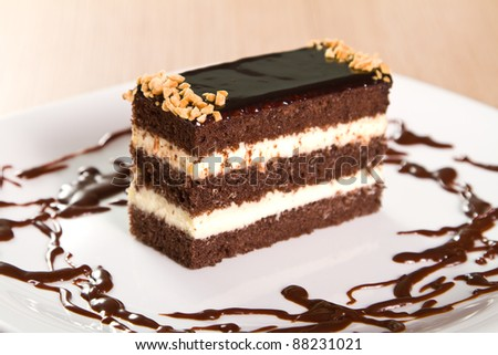 Chocolate cakes with crushed nuts (focus on nuts, shallow DOF) - stock photo
