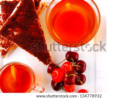 chocolate cakes with tea and cherry - stock photo