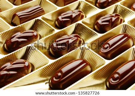 chocolate candies in a gold gift box - stock photo