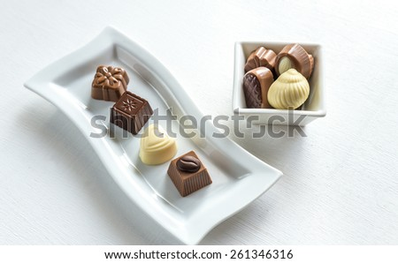 Chocolate candies of different shapes - stock photo