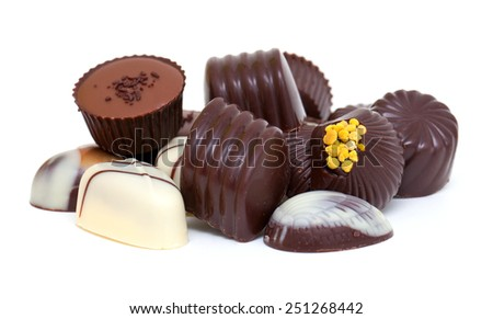 chocolate candies over white background - stock photo