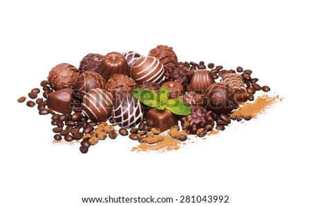 Chocolate candies. Pale of Belgian truffles isolated on white