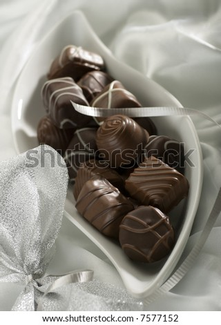 chocolate candy decorated on silk close up shoot