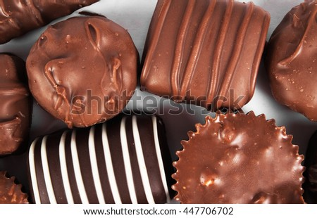 Chocolate candy on a white background. Assorted Chocolate - stock photo