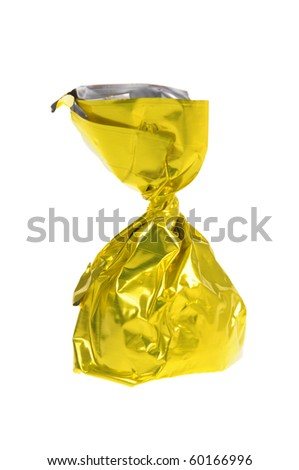 Chocolate candy wrapped in golden paper - stock photo