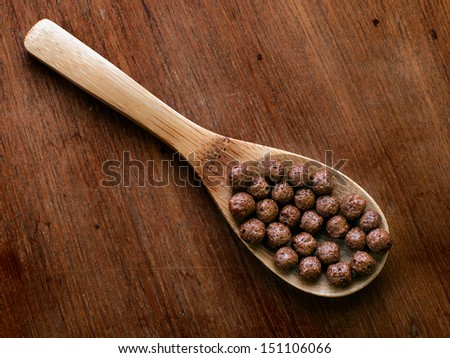 Chocolate cereal on wooden Ladle, still live - stock photo