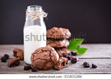 Chocolate cherry cookies and a bottle of milk  - stock photo