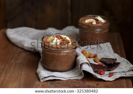Chocolate chia seeds pudding with figs, bananas and goji berries - stock photo