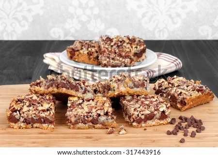 Chocolate chip and nut cookie squares.  Copy space. - stock photo