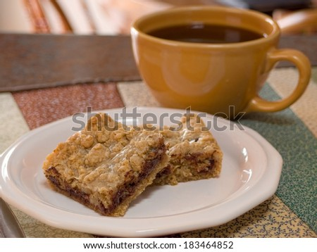 Chocolate Chip and Peanut Butter Dessert Squares and a cup of coffee - stock photo