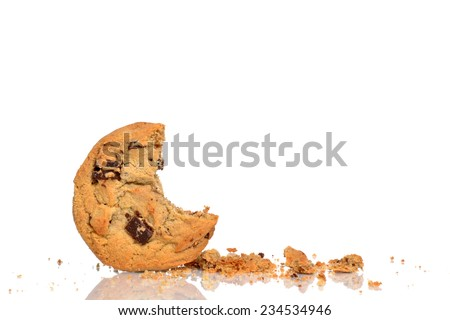 chocolate chip cookie and crumbs isolated white background - stock photo