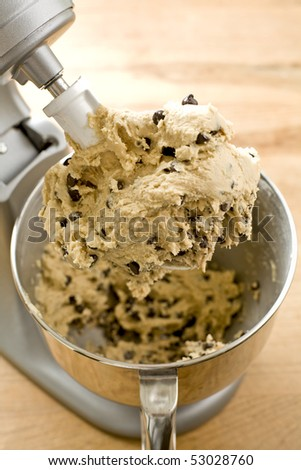Chocolate chip cookie dough in mixer - stock photo