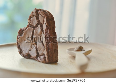 Chocolate chip cookie in the shape of heart, with wooden spoon. Concept about love and relationship. (Soft Style for background) - stock photo
