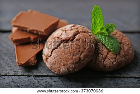 Chocolate chip cookie with chocolate pieces and mint, closeup - stock photo