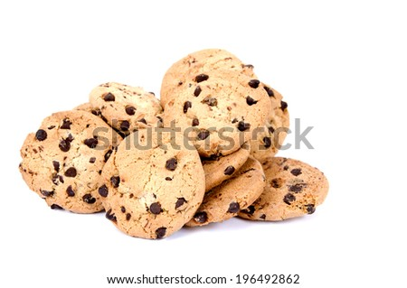 Chocolate chip cookies grouped together in a small pile. - stock photo