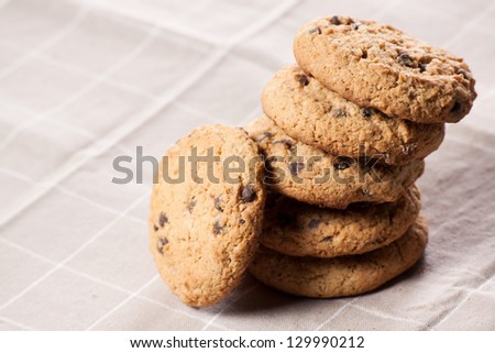 Chocolate chip cookies on brown napkin. - stock photo