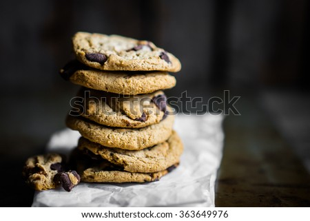 Chocolate chip cookies on rustic background - stock photo