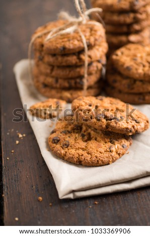 Chocolate chip cookies on rustic wooden background. Selective focus