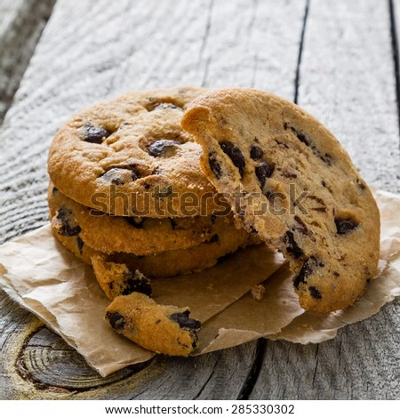 Chocolate chip cookies, rustic wood background, closeup - stock photo