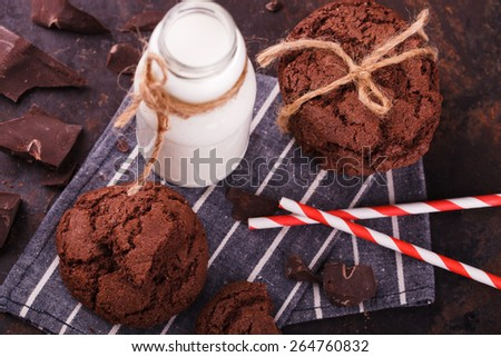 Chocolate chip cookies with milk and chocolate on a dark background.selective focus - stock photo