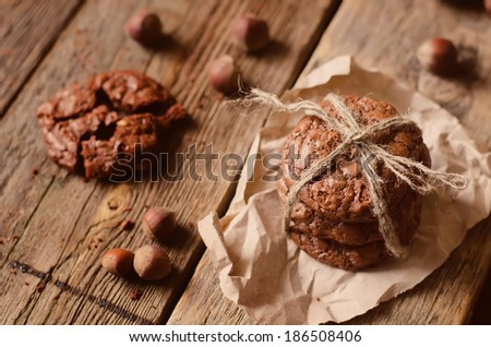 chocolate chip cookies with walnuts on a wood background. toning