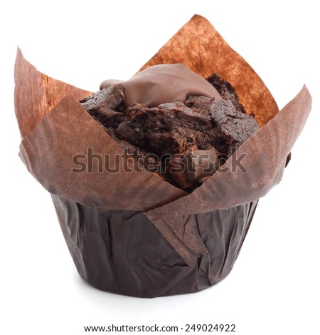 Chocolate chip muffin in brown wax paper. - stock photo