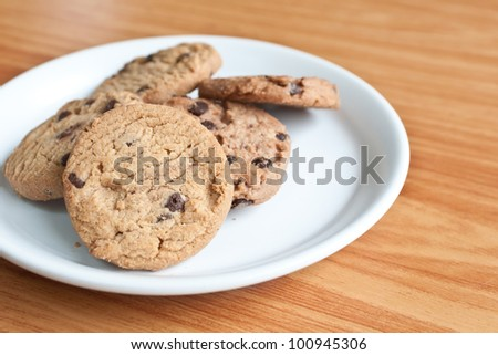 chocolate chips cookies in a dish on  the wood teble. - stock photo