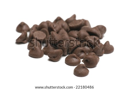 Chocolate chips on white background shallow depth of focus - stock photo