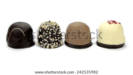 Chocolate coated cream puffs isolated on white background. Danish cuisine. - stock photo