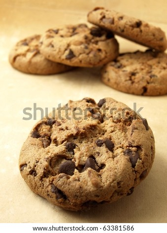 Chocolate cookie in the foreground - stock photo