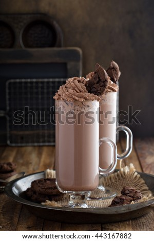 Chocolate cookie milkshake in tall mugs with chocolate whipped cream - stock photo