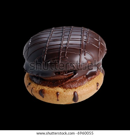 Chocolate cookie on pure black background. Easy to use on your project - stock photo