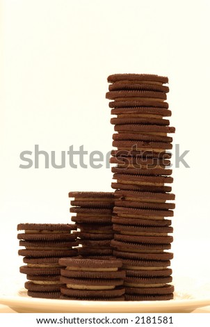 Chocolate Cookies - Chocolate frosting-filled cookies stacked high on a plate.