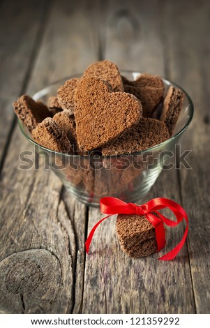 Chocolate Cookies in the Shape of Heart at Day St Valentine on Wooden Background - stock photo