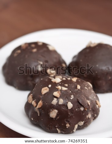 chocolate cookies with peanuts on plate