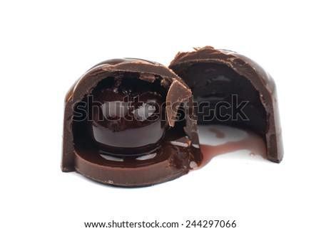 chocolate covered cherries white background - stock photo