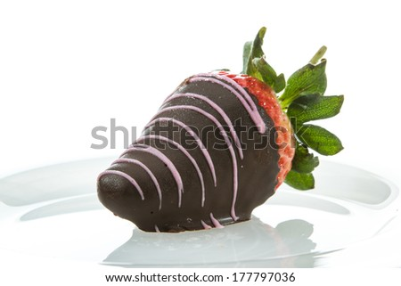 chocolate covered strawberry served on a white plate isolated on a white background - stock photo