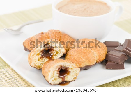Chocolate croissants and cappuccino. - stock photo
