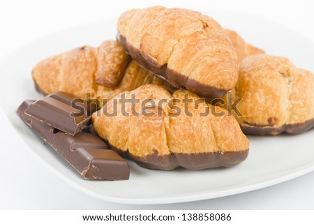 Chocolate croissants on a white background. - stock photo