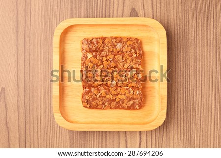 Chocolate crunch on wooden plate