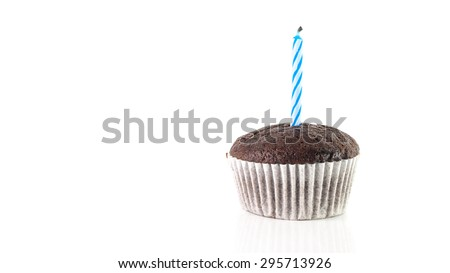 Chocolate Cup Cake With Blue Candle Isolated On White